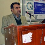 Behram Baloch speaking at the event