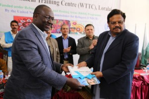 UNHCR's Assistant High Commissioner Mr. George Okoth-Obbo handing over Women Technical Training Centre completion documents to Secretary Labour and Man Power Hamid ul Karim at the opening ceremony in Loralai on Thursday.