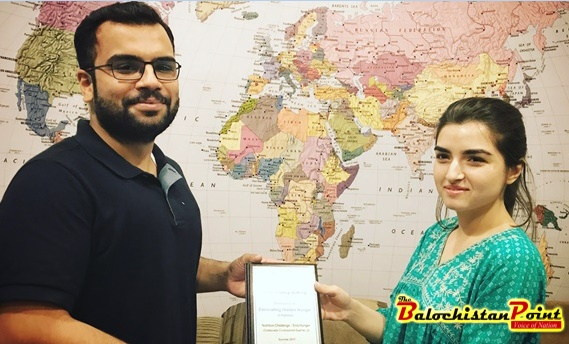 Figure 1: CEO Techlets, Ahsan Tahir receiving the Champion to Eliminate Hidden Hunger from Nida Karim, Program Specialist Eliminating Hidden Hunger, Mishal Pakistan